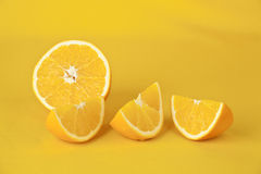 Oranges. On a yellow background royalty free stock images