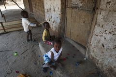 Small children playing at the village of Eticoga in the island of Orango. royalty free stock image