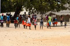 Unidentified local people in traditonal clothes gather to celeb. ORANGO ISLAND, GUINEA BISSAU - MAY 3, 2017: Unidentified local people in traditonal clothes stock photography