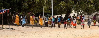 Unidentified local people in traditonal clothes gather to celeb. ORANGO ISLAND, GUINEA BISSAU - MAY 3, 2017: Unidentified local people in traditonal clothes royalty free stock image