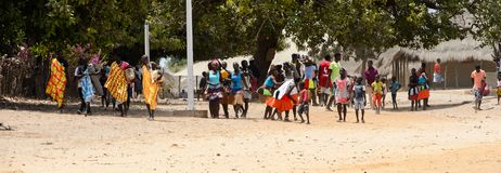 Unidentified local people in traditonal clothes gather to celeb. ORANGO ISLAND, GUINEA BISSAU - MAY 3, 2017: Unidentified local people in traditonal clothes royalty free stock photography