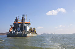 Oranje. A Trailing suction hopper Dredger at Work stock image