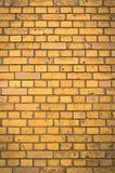 Oranje Bakstenen muur Stock Foto's