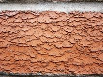 Oranje bakstenen muur dicht omhooggaand detail Stock Foto