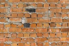 Oranje Bakstenen muur Textuur van een blickmuur royalty-vrije stock fotografie