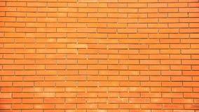 Oranje bakstenen muurpatroon als achtergrond stock afbeelding