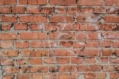 Oranje bakstenen muurtextuur als achtergrond Gebroken bakstenen Royalty-vrije Stock Afbeeldingen