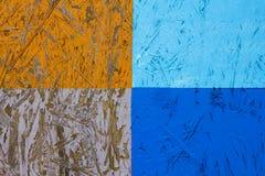 Oranje blauwe witte houtvezelplaat met vier rechthoeken met schilverf Ruwe Oppervlaktetextuur stock foto
