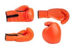 Oranje bokshandschoen in verschillende hoeken stock afbeeldingen