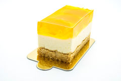 Oranje cake op de witte achtergrond Royalty-vrije Stock Fotografie