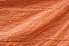 Oranje de textuurachtergrond van de geteerde zeildoekenstof Stock Afbeelding