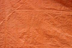 Oranje de textuurachtergrond van de geteerde zeildoekenstof Royalty-vrije Stock Afbeeldingen