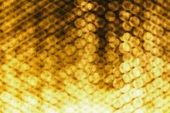 Oranje die achtergrond met achthoeken wordt gemaakt Stock Foto's