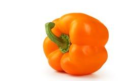 Oranje die peper op een wit wordt geïsoleerd royalty-vrije stock afbeeldingen