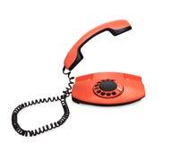 Oranje die telefoon over witte achtergrond wordt geïsoleerd Royalty-vrije Stock Foto