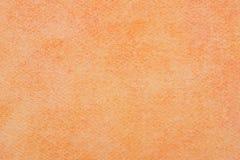 Oranje die waterverf op document achtergrondtextuurmacro wordt geschilderd stock afbeeldingen