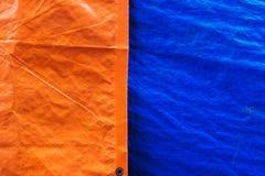 Oranje en blauwe de textuurachtergrond van de geteerde zeildoekenstof Royalty-vrije Stock Foto's