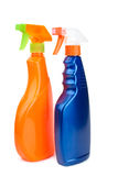 Oranje en blauwe spuitbusflessen Stock Afbeeldingen
