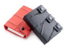 Oranje en zwarte leernotitieboekjes Stock Fotografie
