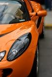 Oranje exotische sportwagen Stock Foto