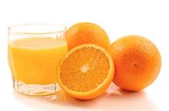 Oranje Früchte und Saft Lizenzfreie Stockfotos