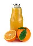 Oranje fruit en een fles sap Royalty-vrije Stock Fotografie