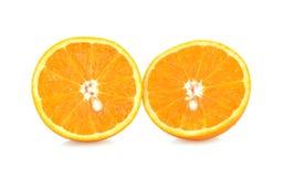 Oranje fruit half op witte achtergrond Stock Foto's
