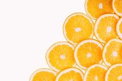 Oranje fruitachtergrond De zomersinaasappelen Gezond Stock Foto's