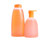 Oranje geïsoleerdeg shampoo en vloeibare zeep Stock Afbeeldingen