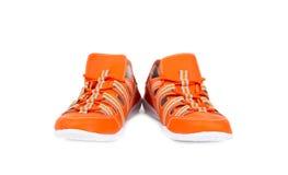 Oranje geïsoleerdeR tennisschoenen Royalty-vrije Stock Afbeeldingen