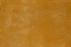 Oranje geborstelde gipspleister met beschadigde verftextuur - mooie abstracte fotoachtergrond royalty-vrije stock afbeelding