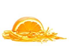Oranje, gesneden schillen Stock Afbeeldingen