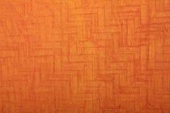 Oranje geweven met de hand gemaakt kunstdocument stock foto