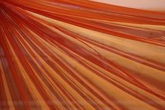 Oranje gordijn stock foto's