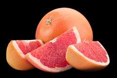Oranje grapefruit op zwarte achtergrond Royalty-vrije Stock Fotografie
