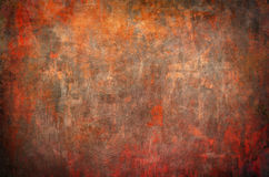Oranje grungeachtergrond Stock Foto's