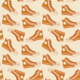 Oranje gumshoes naadloos hipster ontwerp als achtergrond Royalty-vrije Stock Afbeelding
