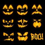 Oranje Halloween-pompoengezichten Stock Afbeeldingen