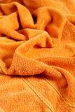 Oranje handdoek stock afbeeldingen