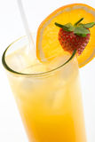 Oranje juice. Glass of orange juice with orange slice and strawberry Royalty Free Stock Image