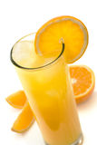Oranje juice. Glass of icy orange juice with orange slice Royalty Free Stock Images