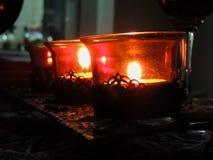 Oranje kaarsen op een rij Stock Fotografie