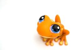 Oranje kikkerstuk speelgoed royalty-vrije stock foto's