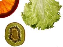 Oranje kiwi en sla Stock Fotografie