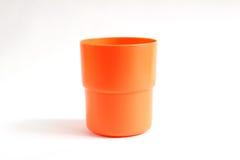 Oranje kleuren plastic glas Royalty-vrije Stock Foto's