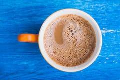 Oranje kop van koffie Stock Foto's