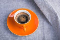 Oranje kop van koffie Stock Afbeeldingen