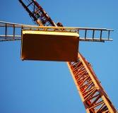 Oranje kraan Stock Foto