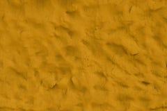 Oranje leeg sjofel patroon van ruwe adobe die als textuur of achtergrond kan worden gebruikt stock afbeelding