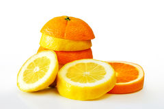 Oranje Lemon. Composition of a pile of juicy orange and lemon slices Stock Photos